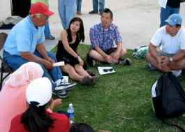 Bob Uyeyama (left) telling his story during small group discussions during the 2008 Manzanar At Dusk program at Lone Pine High School.