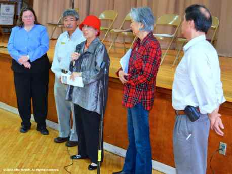 Lillian Kawasaki (holding microphone) is recognized for her years of service to the Friends of Manzanar, joined by (from left): Alisa Lynch, Les Inafuku, Rose Ochi, and Bruce Embrey. ©2012 Alan Broch. All rights reserved.