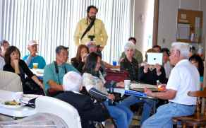 Hank Umemoto (at right), shown here telling a story to the audience.