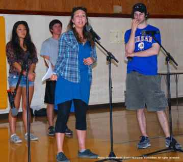 """An open mic session follows the small group discussions, where spoken word, musical performances, dance and just about anything else can happen, including announcing related events and projects, as Kazuko Golden is doing in this photo regarding the making of her film, """"The Song."""""""