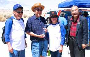Warren Furutani (second from left)