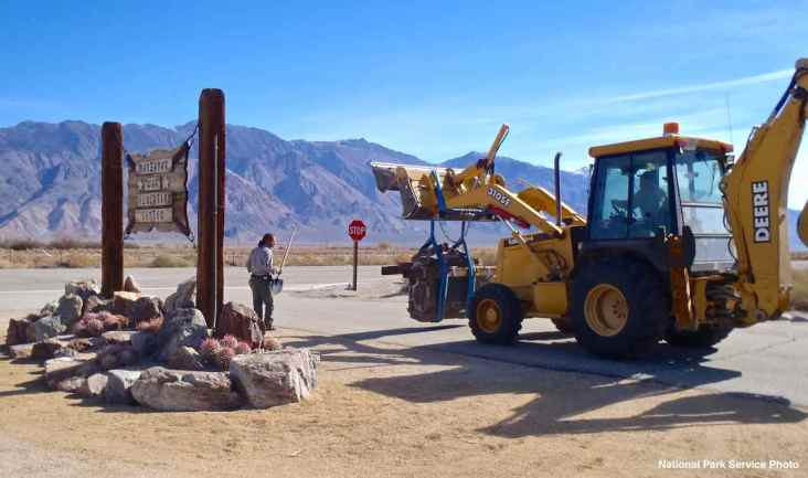 Using a skiploader, National Park Service staff haul the California Registered Historical Landmark plaque to the Visitors Center via the frontage road to the immediate east of the site.