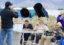Manzanar Committee Co-Chair Bruce Embrey (left) is shown here taking a photo of Kanji Sahara (second from left), Mo NIshida (center) and Hank Umemoto (right).