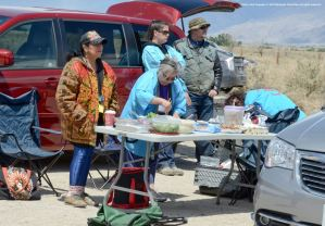 Members of the Manzanar Committee preparing their traditional lunch behind-the-scenes.