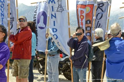 Banners representing the Heart Mountain, Jerome, Manzanar Minidoka, Poston, and Rohwer concentration camps are shown here.