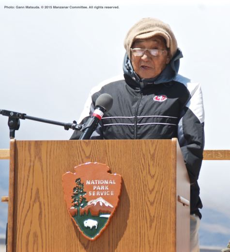 Former Manzanar incarceree Wilbur Sato recites a poem he wrote, honoring incarcerees from Bainbridge Island, Washington.