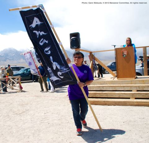 Banners representing all of the American concentration camps during World War II, the Crystal City Internment Camp, and a banner honoring the 100th Battalion/442nd Regimental Combat Team/Military Intelligence Service, are part of each year's Manzanar Pilgrimage. Melany Okafuji-Lucia carried the Amache banner.
