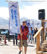 Banners representing all of the American concentration camps during World War II, the Crystal City Internment Camp, and a banner honoring the 100th Battalion/442nd Regimental Combat Team/Military Intelligence Service, are part of each year's Manzanar Pilgrimage. David Fujioka carried the Heart Mountain banner.