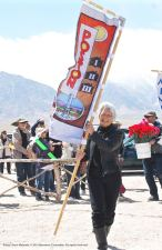 Banners representing all of the American concentration camps during World War II, the Crystal City Internment Camp, and a banner honoring the 100th Battalion/442nd Regimental Combat Team/Military Intelligence Service, are part of each year's Manzanar Pilgrimage. Former Poston incarceree Hatsuko Mary Higuchi carried the Poston banner.