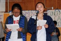 College students organize the Manzanar At Dusk program, which begins with a creative presentation in which portions of actual stories from former incarcerees are portrayed. Shown here are UCSD Nikkei Student Union members Kelsey Nakamura (at the mic) and Rena Ogino (background).