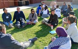 One of the small group discussions during the 2015 Manzanar At Dusk program. Andy Noguchi Co-President, Florin JACL, is background left.