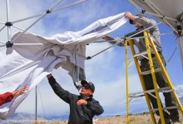 A pre-Pilgrimage scene...putting up the canopies. That's Manzanar Commitee Co-Chair Bruce Embrey (center).