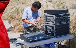 Sound engineer Yoshi Irie prepares the audio equipment for the 46th Annual Manzanar Pilgrimage.