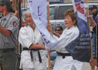 Ernie Jane Nishi (left) and Nancy Oda (right) carried the Tule Lake banner.