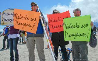 "Members of the Florin JACL and CAIR-Sacramento Valley hold up signs that read, ""Watashi wa Manzanar"" (I am Manzanar) at the conclusion of Dr. Satsuki Ina's keynote speech at the 46th Annual Manzanar Pilgrimage."
