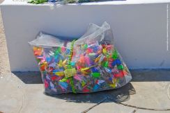 1,000 origami cranes, waiting to be draped around the Manzanar cemetery monument.