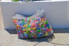 1,000 origami cranes, waiting to be draped around the Manzanar cemetery monument.