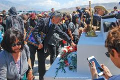 The flower offering during the traditinal interfaith service at the Manzanar cemetery.