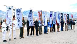 Banners representing all ten War Relocation Authority concentration camps, along with the 100th/442nd MIS, shown here during the 47th Annual Manzanar Pilgrimage, April 30, 2016, Manzanar National Historic Site.