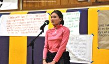 A participant from the 2016 Manzanar At Dusk program. shown here speaking during the open mic wrap-up session.