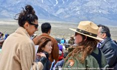 Maytha Alhassen (left), one of the speakers during the 47th Annual Manzanar Pilgrimage with Alisa Lynch, Chief of Interpretation, Manzanar National Historic SIte (right). Background left is keynote speaker, Dr. Cathy Irwin.