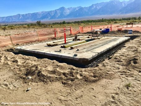 September 2016: Initial work on constructing an historic replica of the Block 14 women's latrine at Manzanar National Historic Site. In this photo, the historic concrete slab foundation is being reinforced with rebar to meet current seismic standards.