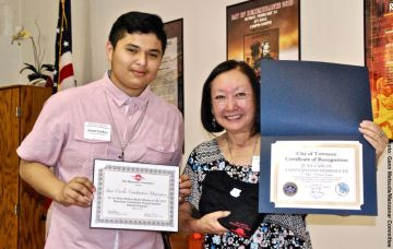 Student Awards recipient Juan Carlos Constantino Dominguez with Manzanar Committee member Colleen Miyano