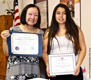 Student Awards recipient Emely Martinez with Manzanar Committee member Colleen Miyano