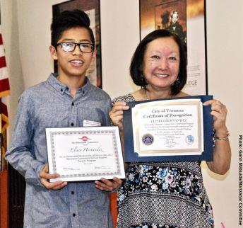 Student Awards recipient Eliseo Hernandez with Manzanar Committee member Colleen Miyano