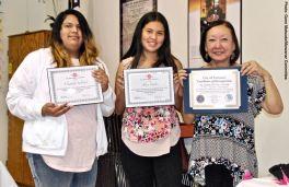 Student Awards recipients Elizabeth Salvador (left) and Alexa Castro (center) with Manzanar Committee member Colleen Miyano