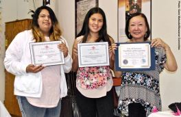 Student Awards recipients Elizabeth Salvador (left) and Alexa Castro (center) with Manzanar Committee member Colleen Miyano