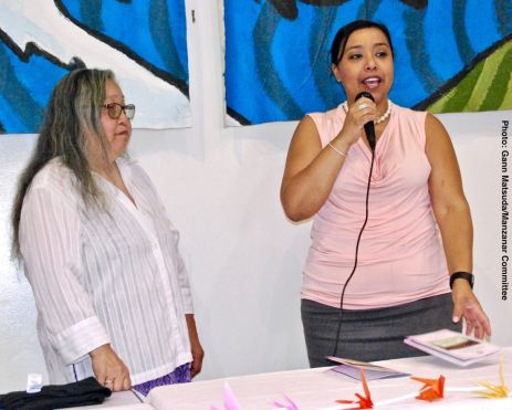 Honorable Tasha Cerda, Mayor, City of Gardena (right) greets the audience, with Manzanar Committee Co-Chair Jenny Chomori (left)