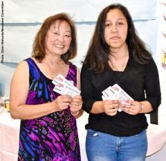 Ashley Mejia (left) with her raffle prize, shown here with Manzanar Committee member Kerry Cababa