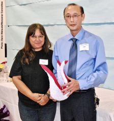 Cliff Kusaba (right) with his raffle prize, shown here with Vicky Perez