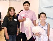 Juan Carlos Constantino Dominguez (center) and Sara Omura (right) with raffle prizes, shown here with Vicky Perez (left)