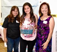 Alexa Castro (center) with her raffle prize, shown here with Vicky Perez (left) and Kerry Cababa (right)