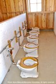 One row of communal toilets in the Block 14 women's latrine. Note the absence of partitions