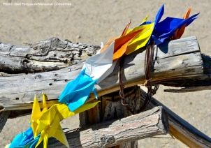 Origami cranes left on the Manzanar cemetery fence