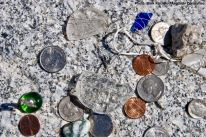 Coins left as an offering on the cemetery monument