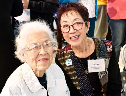 Aiko Herzig-Yoshinaga with NCRR's Kay Ochi (right).