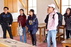 Students listening to Manzanar National Historic Site Ranger Mark Hachtmann discussing living conditions at Manzanar during World War II. This photo was taken inside the Block 14 barrack (1944 conditions).