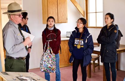 Students listening to Manzanar National Historic Site Ranger Mark Hachtmann discussing living conditions at Manzanar during World War II. This photo was taken inside the Block 9 barrack (1944 conditions).