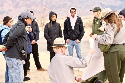 Students with Manzanar National Historic SIte Rangers near the administration area at Manzanar.