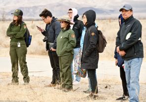"Listening to Manzanar National Historic Site Ranger Patricia Biggs during her presentation on the Manzanar ""Riot."""