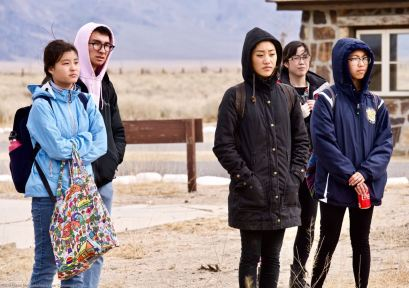 Students near the historic entrance to Manzanar, where the military police and sentry posts are located.