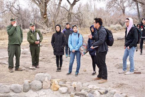 Manzanar National Historic SIte's Chief of Cultural Resources Division Jeff Burton (left) told the students more about the many World War II-era gardens, and how oral histories and archeology were being used together to unearth more and more gardens.