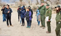 Manzanar National Historic SIte's Chief of Cultural Resources Division Jeff Burton (third from right) told the students more about the many World War II-era gardens, and how oral histories and archeology were being used together to unearth more and more gardens.