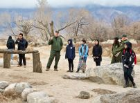 Manzanar National Historic SIte's Chief of Cultural Resources Division Jeff Burton (third from left) told the students more about the many World War II-era gardens, and how oral histories and archeology were being used together to unearth more and more gardens. This photo was taken at Manzanar's best-known garden, Merritt Park.
