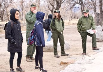 Manzanar National Historic SIte's Chief of Cultural Resources Division Jeff Burton (background left) told the students more about the many World War II-era gardens, and how oral histories and archeology were being used together to unearth more and more gardens.