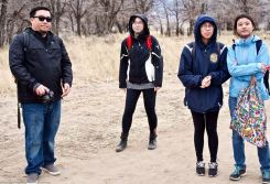 Students and the Manzanar Committee's Jason Fujii (left) and Wendi Yamashita (second from left) listening to Manzanar National Historic SIte's Chief of Cultural Resources Division Jeff Burton talk about the many World War II-era gardens, and how oral histories and archeology were being used together to unearth more and more gardens.